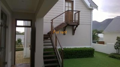 Access to upstairs flatlet with 1 bedroom, en-suite bathroom and small kitchenette