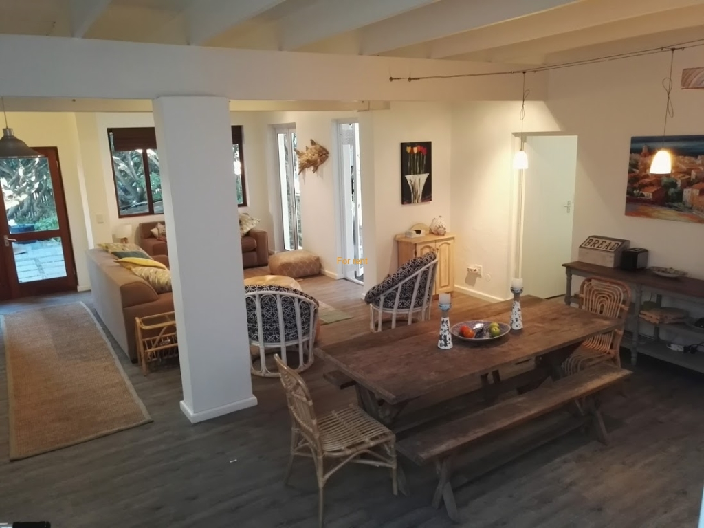 Open plan living area with outside patio area and lapa braai in lovely garden area